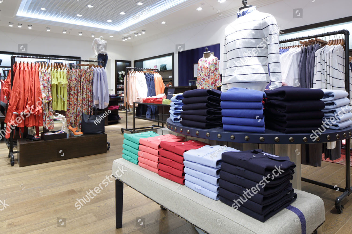 stock-photo-luxury-and-fashionable-brand-new-interior-of-cloth-store-193989149